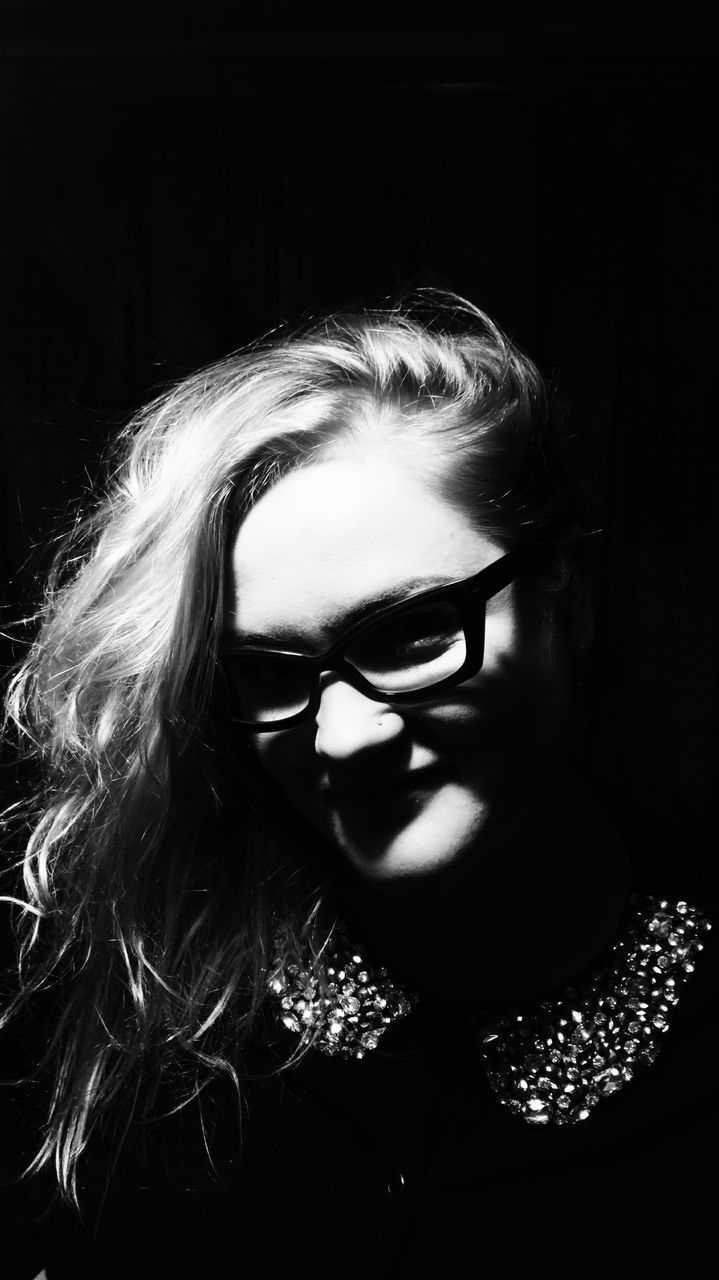one person, real people, studio shot, black background, portrait, young women, looking at camera, headshot, indoors, young adult, eyeglasses, night, close-up, beautiful woman, blond hair, halloween, people