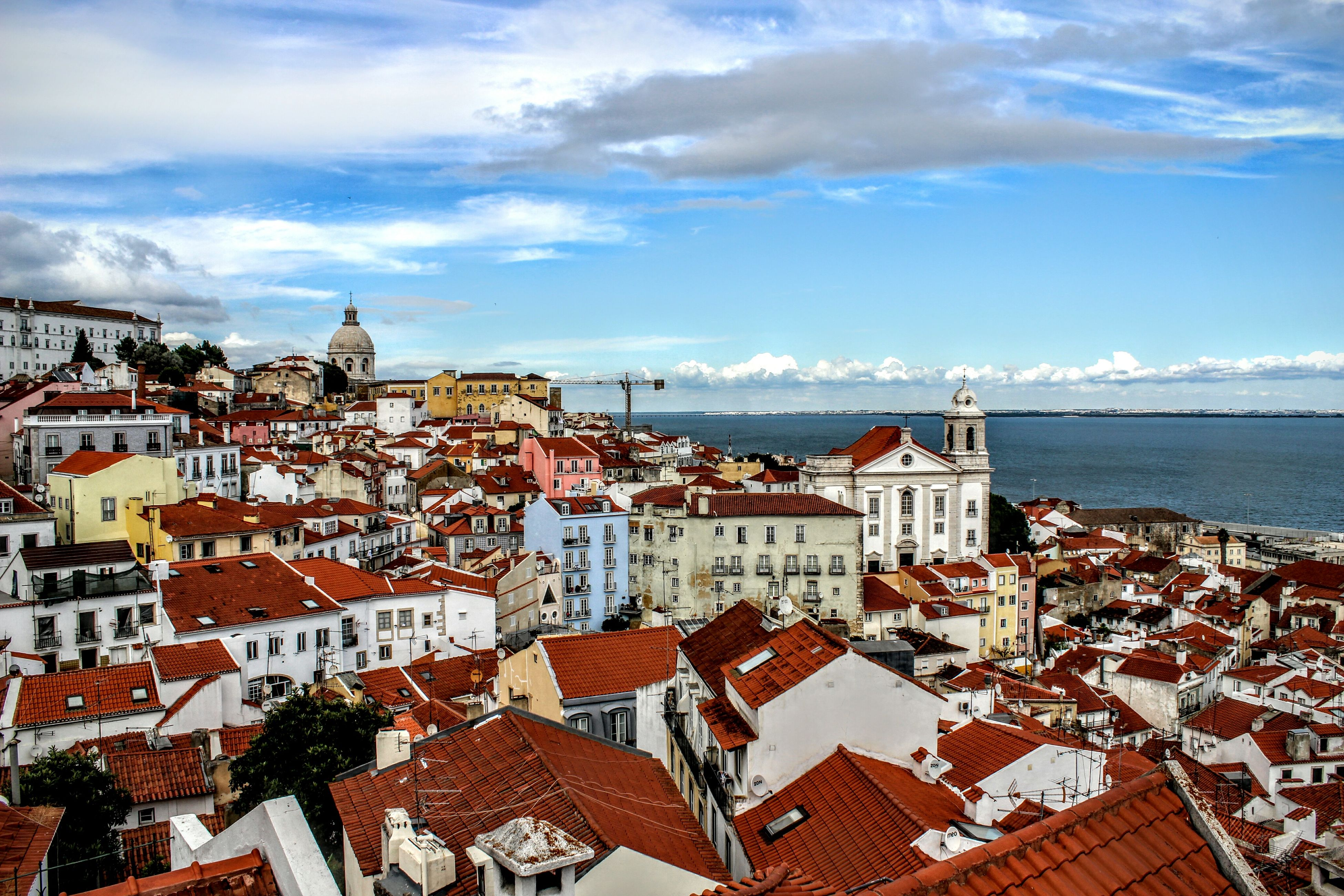 architecture, building exterior, built structure, sky, sea, roof, residential structure, water, cloud - sky, house, high angle view, residential building, town, residential district, horizon over water, townscape, cloud, city, cloudy, cityscape