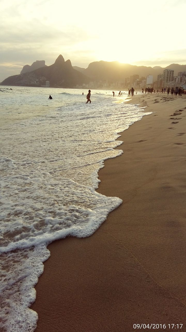 beach, sea, sand, water, shore, nature, vacations, wave, beauty in nature, scenics, real people, leisure activity, outdoors, tranquil scene, tranquility, sunset, lifestyles, travel destinations, men, day, sky, one person, horizon over water, people