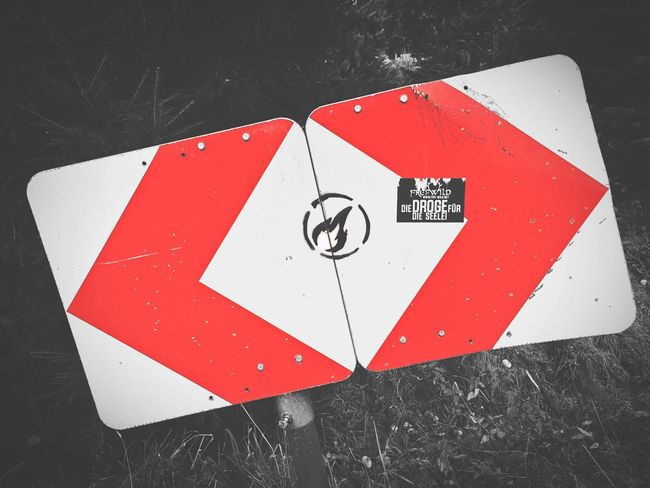 EyeEm Nature Lover TakeoverContrast Red Communication Warning Sign Guidance Road Sign Danger Sign Forbidden Close-up High Angle View Symbol Information Sign Circle Outdoors Damaged Weathered Luxxxs Taking Photos Hanging Out Blackandwhite Non-urban Scene Shield Walking Around