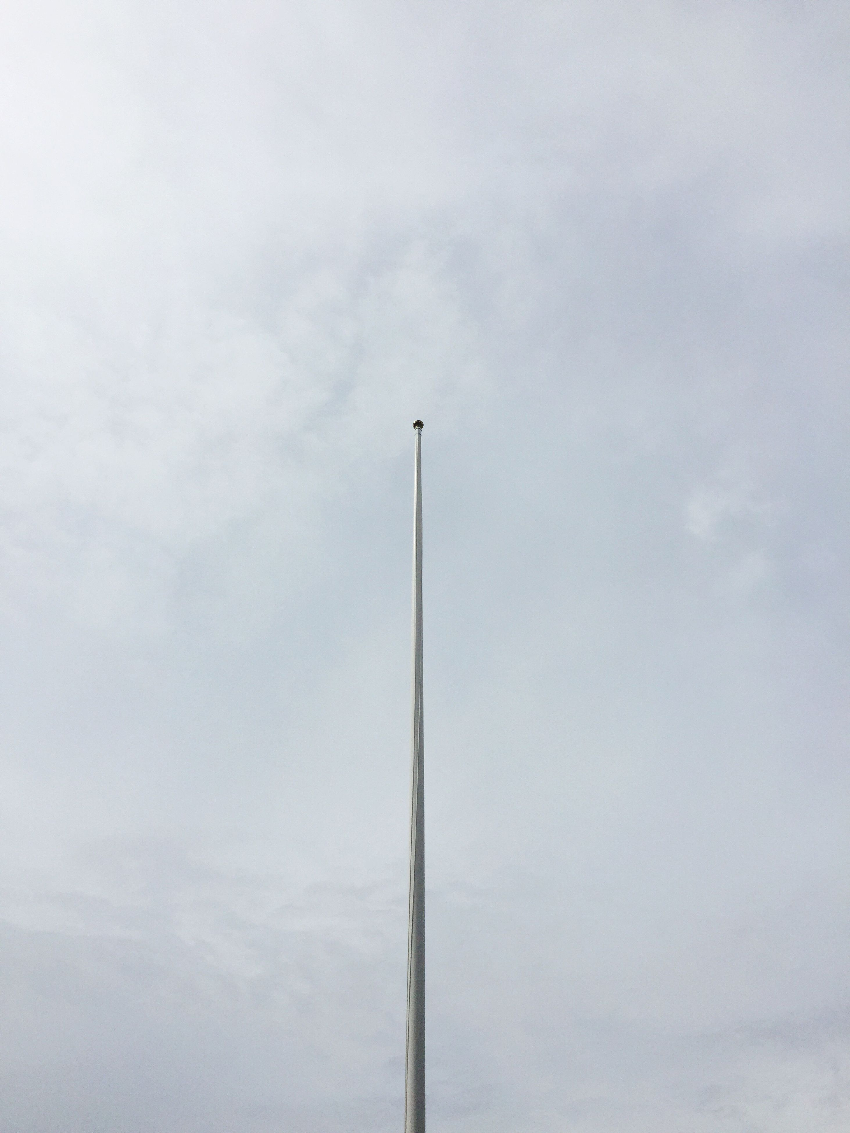 low angle view, cloud - sky, sky, no people, flag, day, outdoors, nature