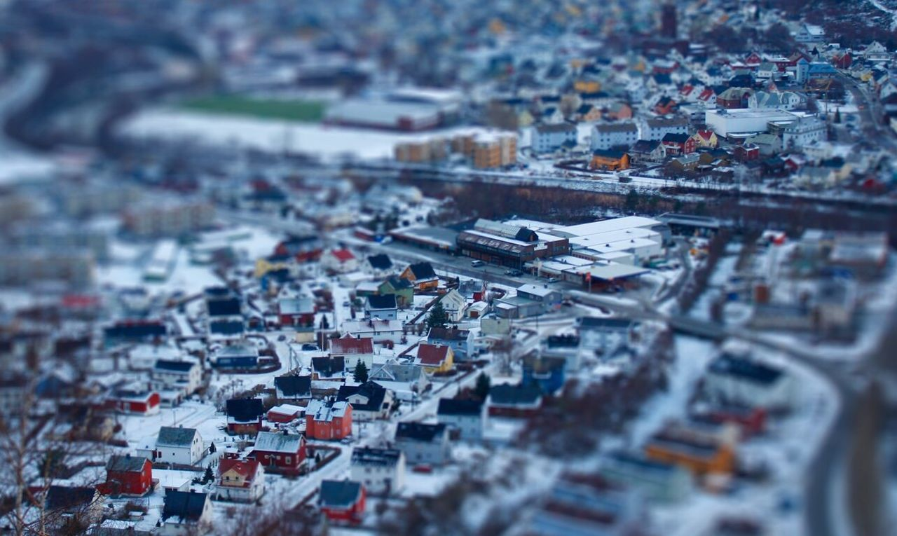 city, selective focus, no people, cityscape, building exterior, architecture, tilt-shift, high angle view, built structure, outdoors, transportation, day, close-up