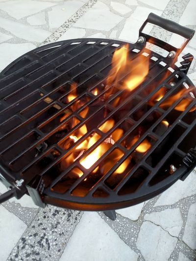 Barbecue Fire Grill close-up Backyard Barbecue BBQ Time Blaze Charcoal Close-up Day Fire Flame Food Grate Grill No People Outdoors Tools