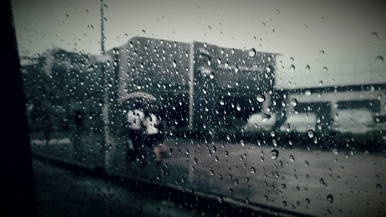 Yes, it was a raining day and a beautiful moment for a couple while I was all alone... Rain Raindrops Raining Day Raining Outside Through My Car Window Couple Photography Umbrella