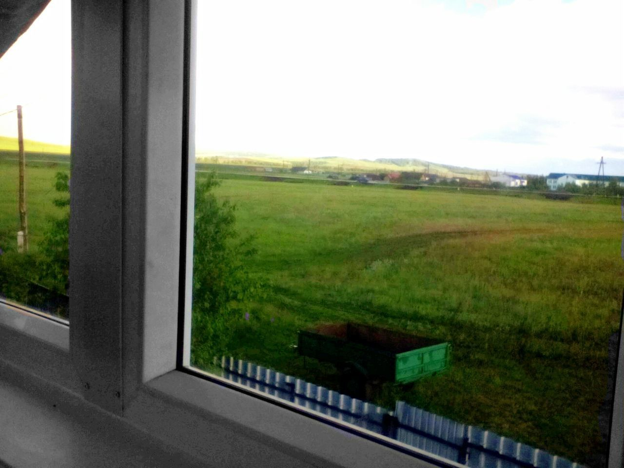 window, field, no people, sky, landscape, day, nature, grass, tree, road, scenery, indoors, close-up