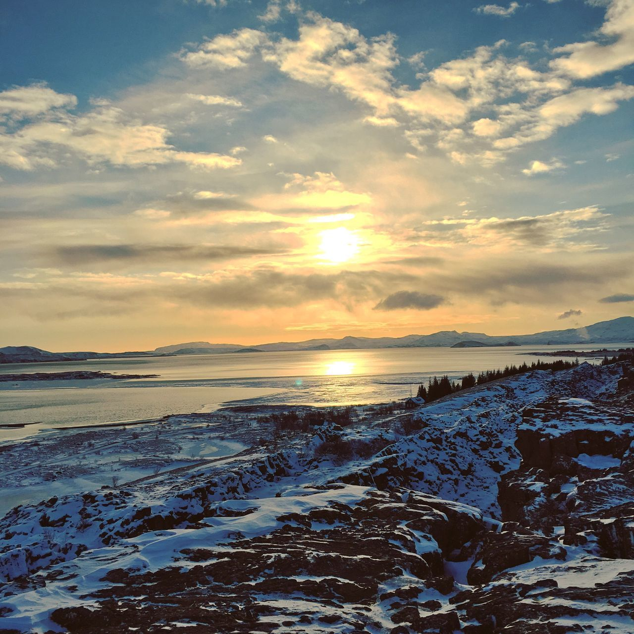 Thingvellir, Iceland Cold Temperature Snow Winter Sunset Beauty In Nature Nature Scenics Sky Tranquil Scene Tranquility Ice Weather Frozen Sun No People Outdoors Cloud - Sky Sea Cold Landscape Iceland Reykjavik Thingvellir National Park EyeEm Nature Lover Capture The Moment EyeEmNewHere