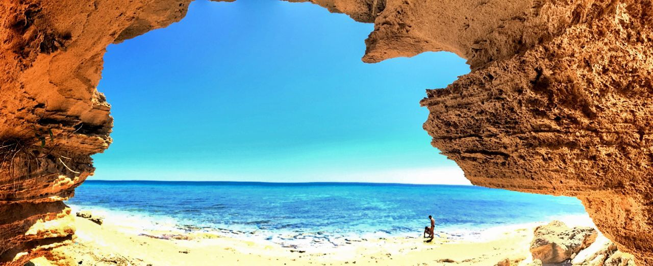 Live For The Story Sea Beach Nature Horizon Over Water Natural Arch Rock Formation Rock - Object Beauty In Nature Water Blue Vacations Clear Sky Travel Destinations Sky Day Sand Outdoors Tranquil Scene Tranquility The Great Outdoors - 2017 EyeEm Awards Live For The Story EyeEmNewHere