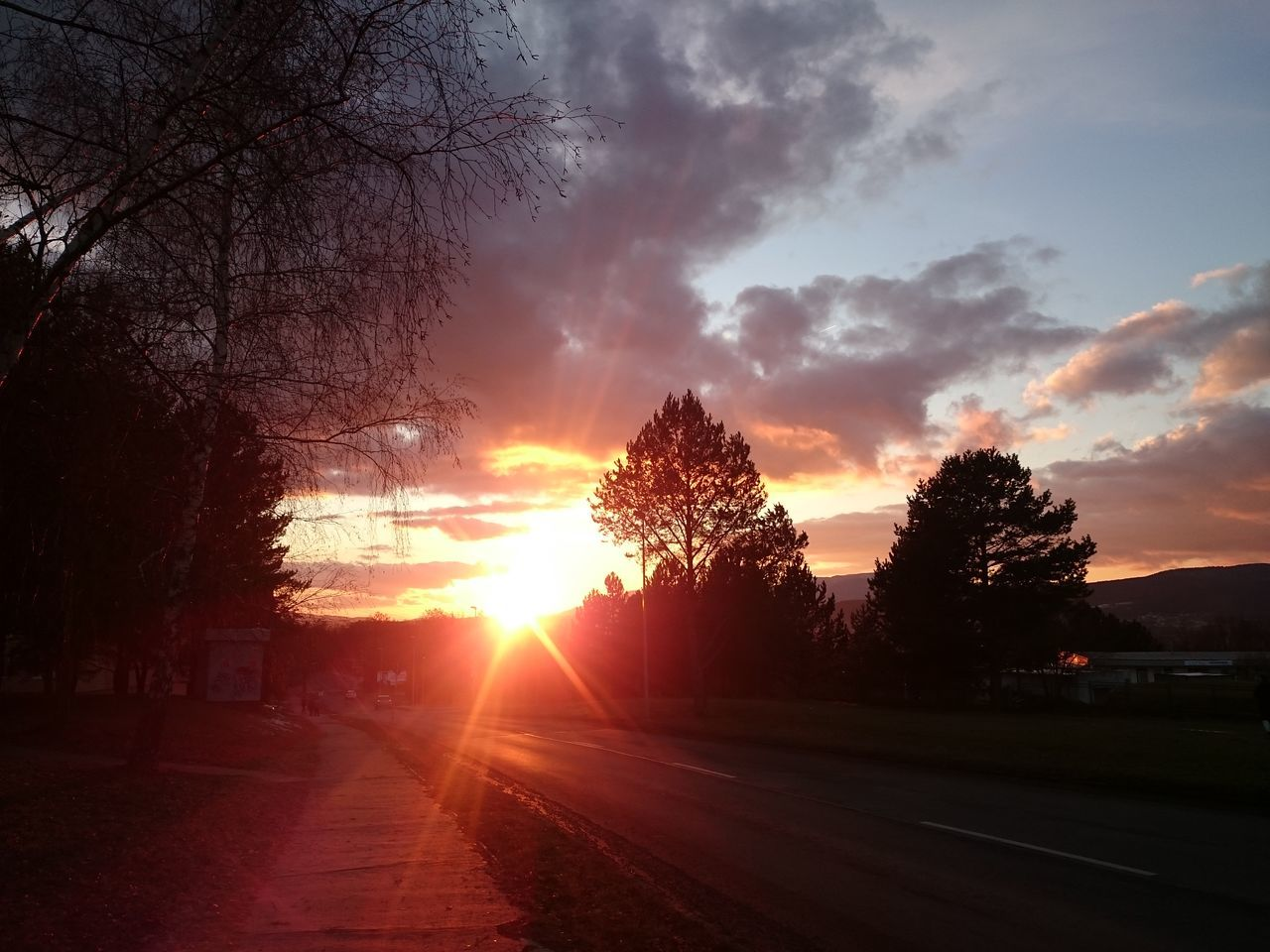 sunset, tree, sun, sky, road, silhouette, scenics, nature, no people, beauty in nature, tranquil scene, tranquility, sunlight, transportation, outdoors, the way forward, cloud - sky, day