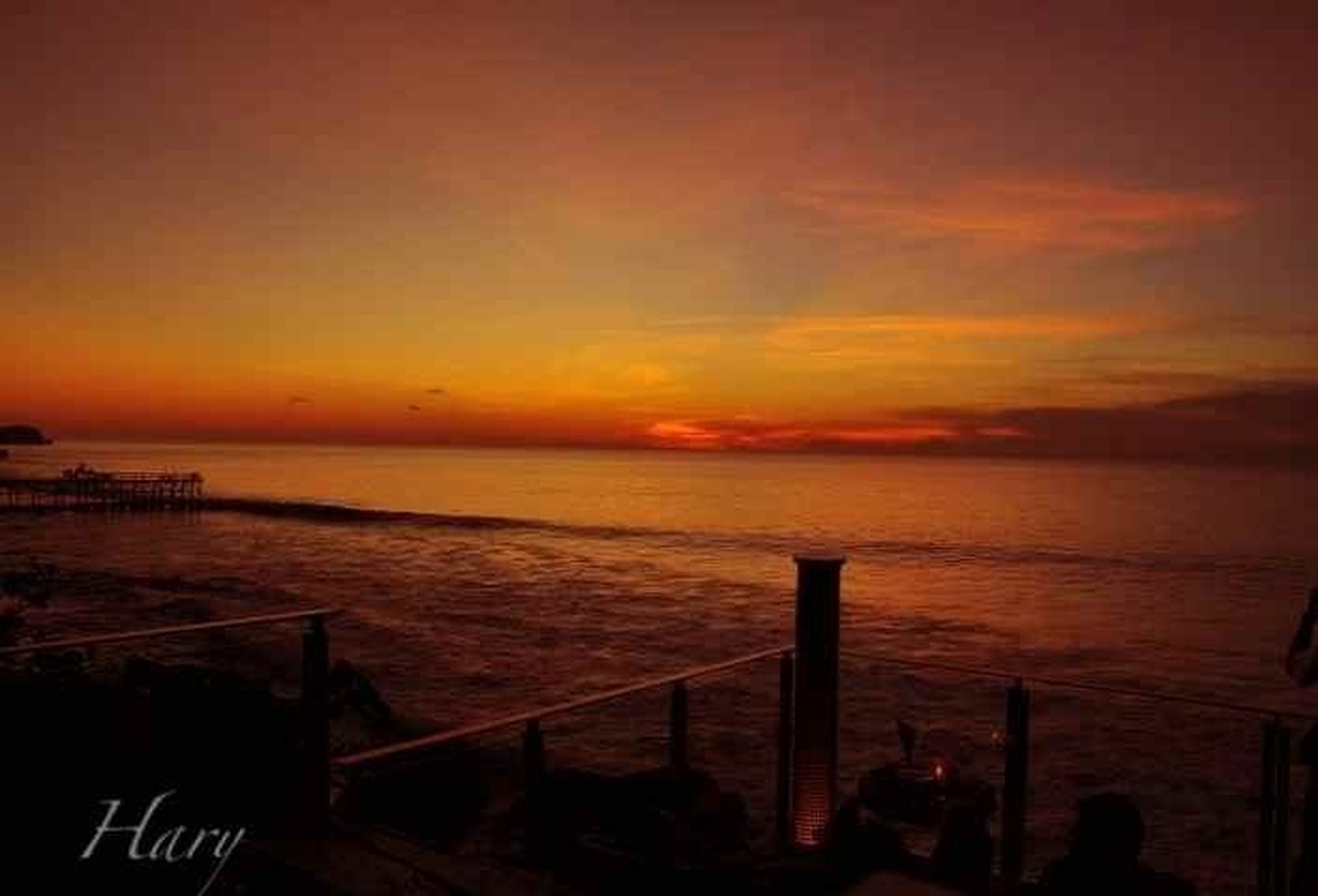 sunset, sea, water, horizon over water, scenics, tranquil scene, beauty in nature, tranquility, sky, orange color, idyllic, nature, beach, silhouette, pier, cloud - sky, outdoors, calm, no people, shore