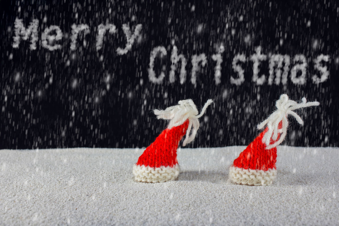 Christmas-hats and snow falling from the sky Sky Background Cap Celebration Christmas Claus December Decoration Festive Gift Merry Santa Snow White Winter Xmas