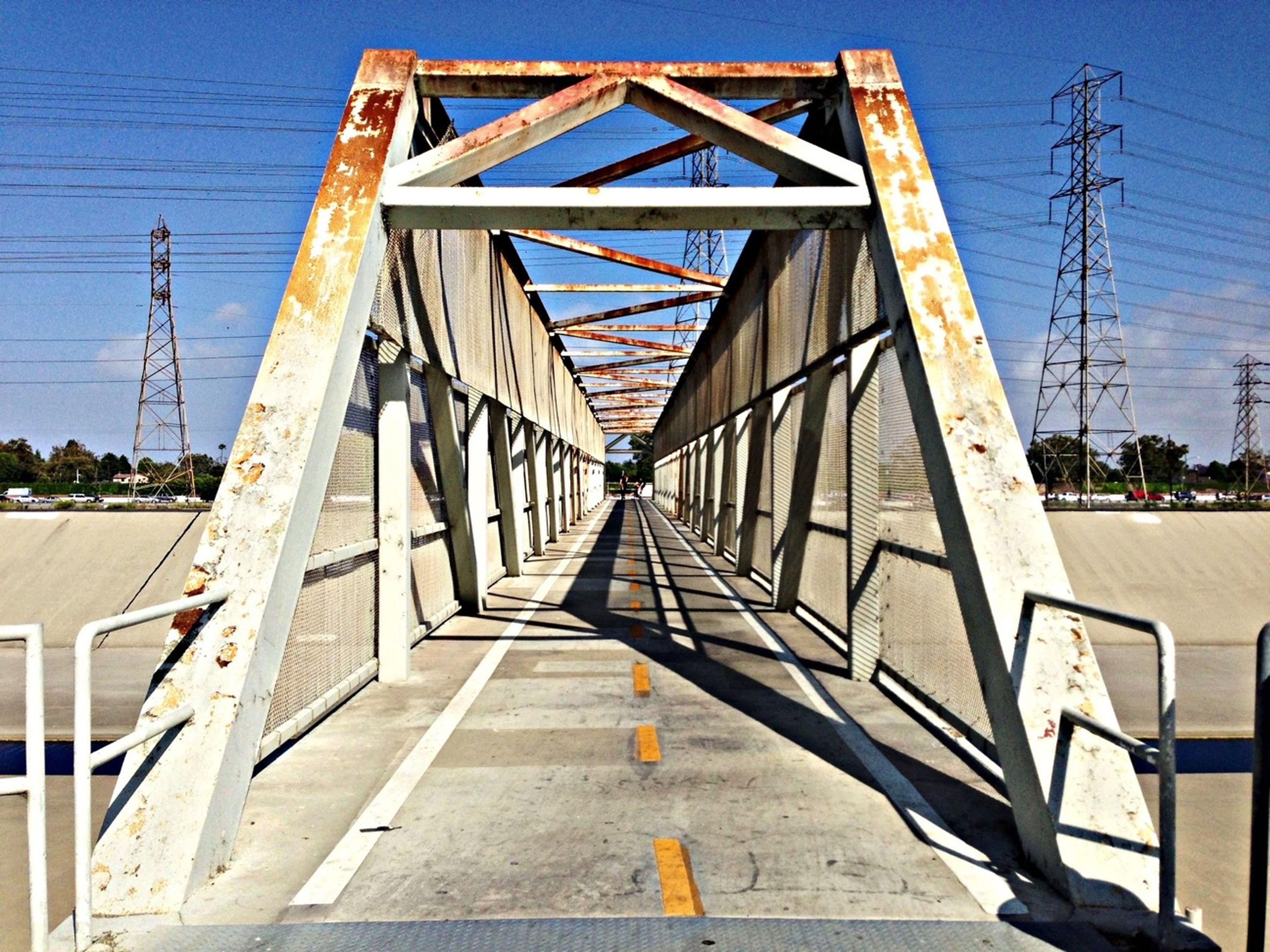 connection, the way forward, built structure, architecture, diminishing perspective, bridge - man made structure, transportation, long, railing, vanishing point, sky, bridge, narrow, cable, footbridge, engineering, electricity pylon, outdoors, power line, no people