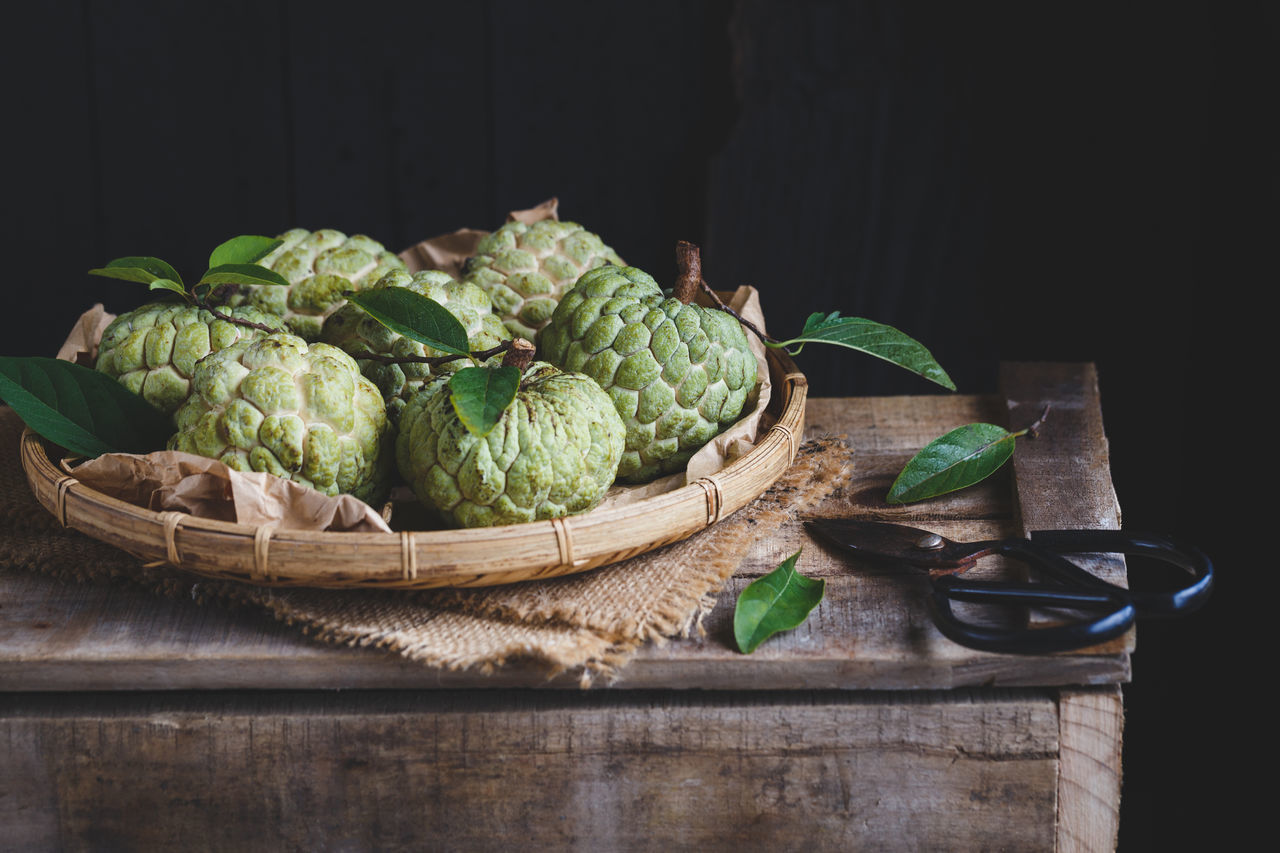 Custard apples on the old wood ASIA Bamboo Basket Burlap Custard Apple Dark Food Food And Drink Fresh Fruit Green Heathy Food Leaf Mãng Cầu Nature Old Wood Plant Raw Sweet Tasty Vietnam Vietnamese Fruit