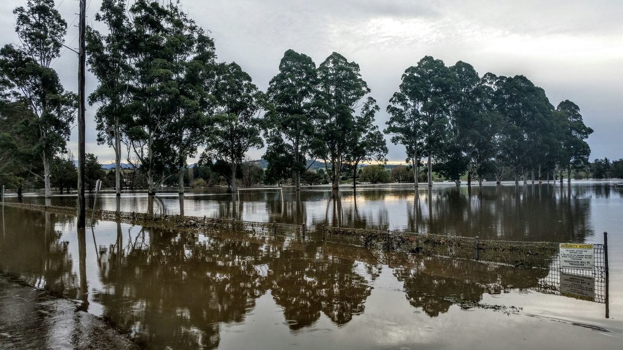 At the end of the day, the rain has gone and the mess will be cleaned up when the water subsides. Muddy Waters Flood Line Flooded Hanging Out Taking Photos Check This Out Water Reflection Waterscape Rainy Days Water_collection Ladyphotographerofthemonth Samsungphotography Underwater Fenceline