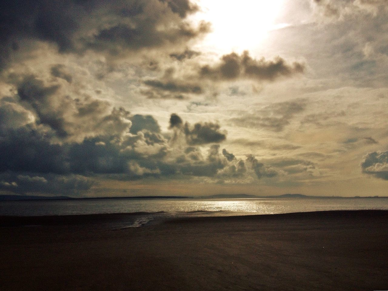 sea, beach, horizon over water, water, scenics, nature, sky, tranquil scene, beauty in nature, tranquility, idyllic, sunset, landscape, no people, cloud - sky, sand, outdoors, horizon, day