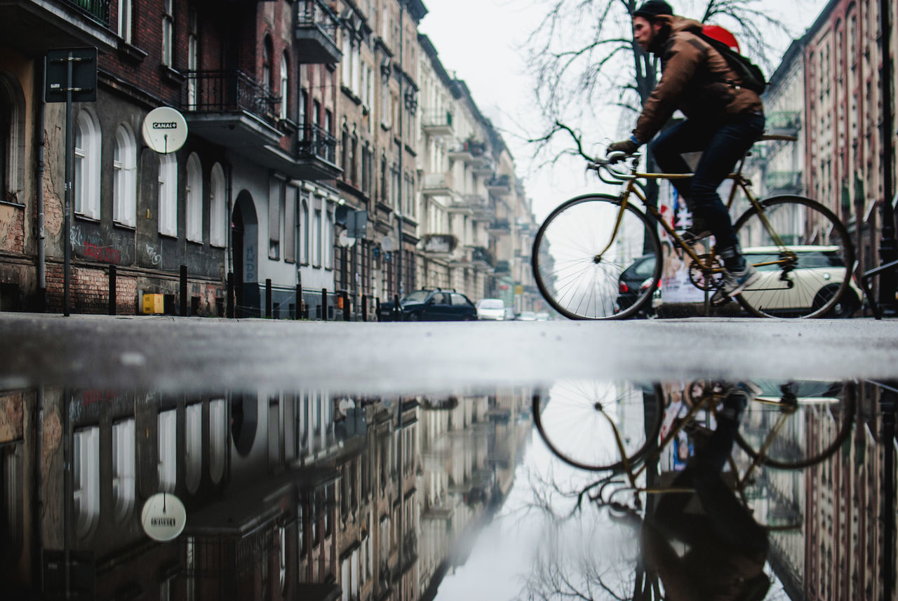 Adult Adults Only Athlete Bicycle Bike City Cycling Day Discover Your City Light And Shadow Men Mode Of Transport Nikon One Man Only One Person Only Men Outdoors People Puddle Reflection Sky Street The Week Of Eyeem Transportation Water