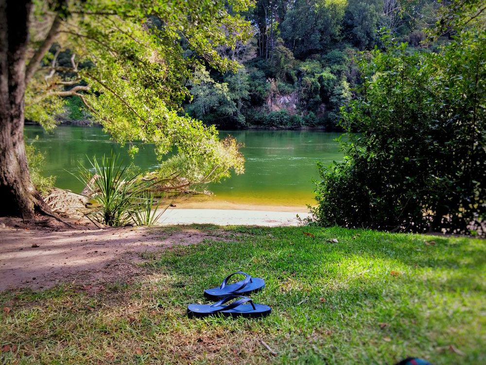 My son and i found the perfect spot for a picnic today😍 Travel Destinations New Zealand Landscape Riverbank Showcase March Hamilton NZ Picnic River Grass Outdoor Photography The KIOMI Collection Native Birds Colour Image Native Bush Breathtaking View No People Relaxation Tranquil Scene Serenity Jandals Shoes Off Sunshine Reflections In The Water Landscapes With WhiteWall Floating On Water The Great Outdoors - 2016 EyeEm Awards