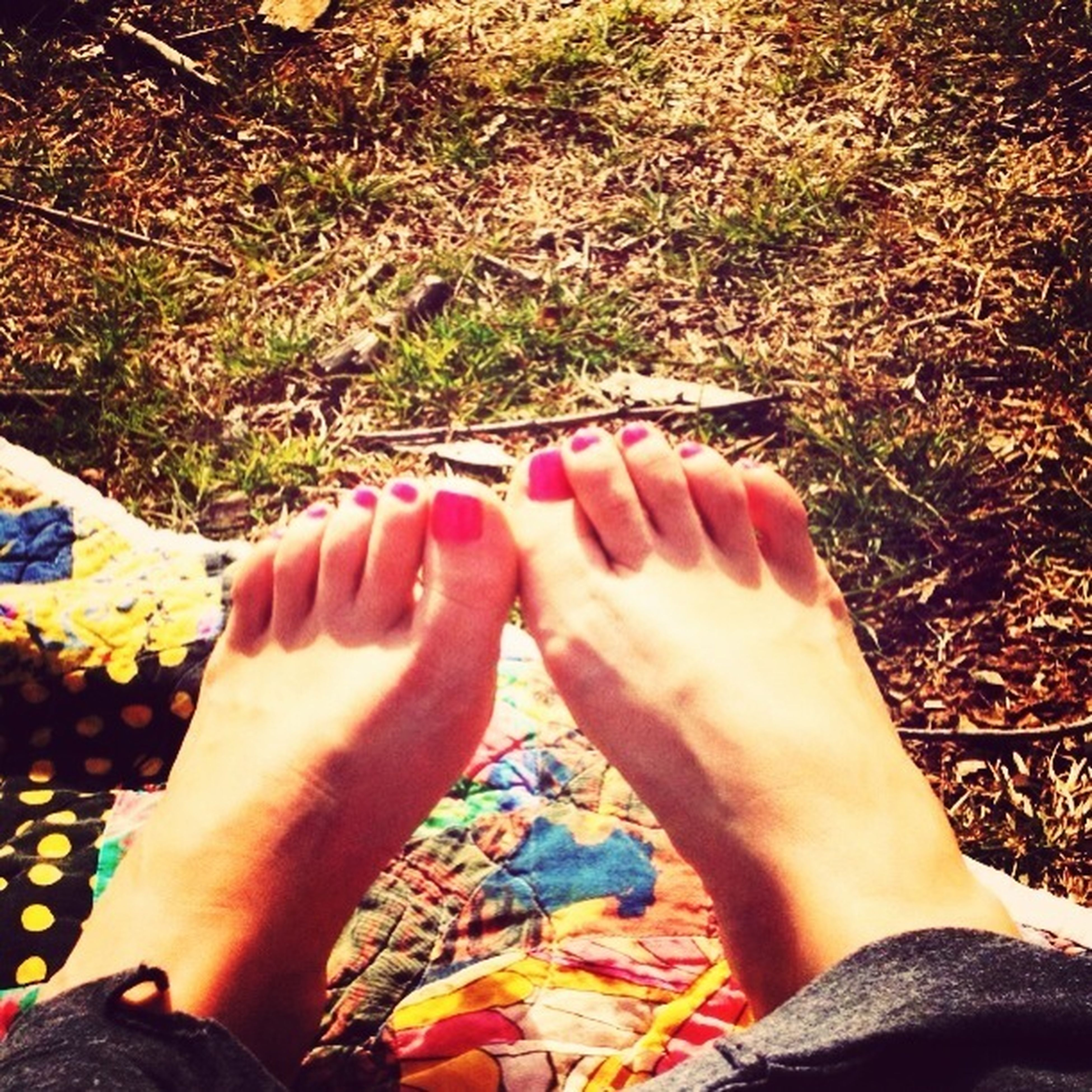 low section, person, personal perspective, human foot, lifestyles, leisure activity, part of, barefoot, unrecognizable person, high angle view, field, outdoors, shoe, sunlight, day