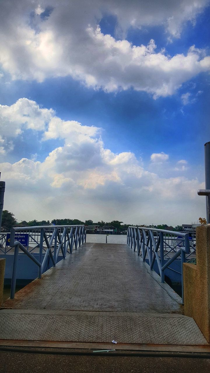 sky, cloud - sky, railing, bridge - man made structure, connection, outdoors, sea, bridge, built structure, the way forward, architecture, water, day, footbridge, nature, horizon over water, no people