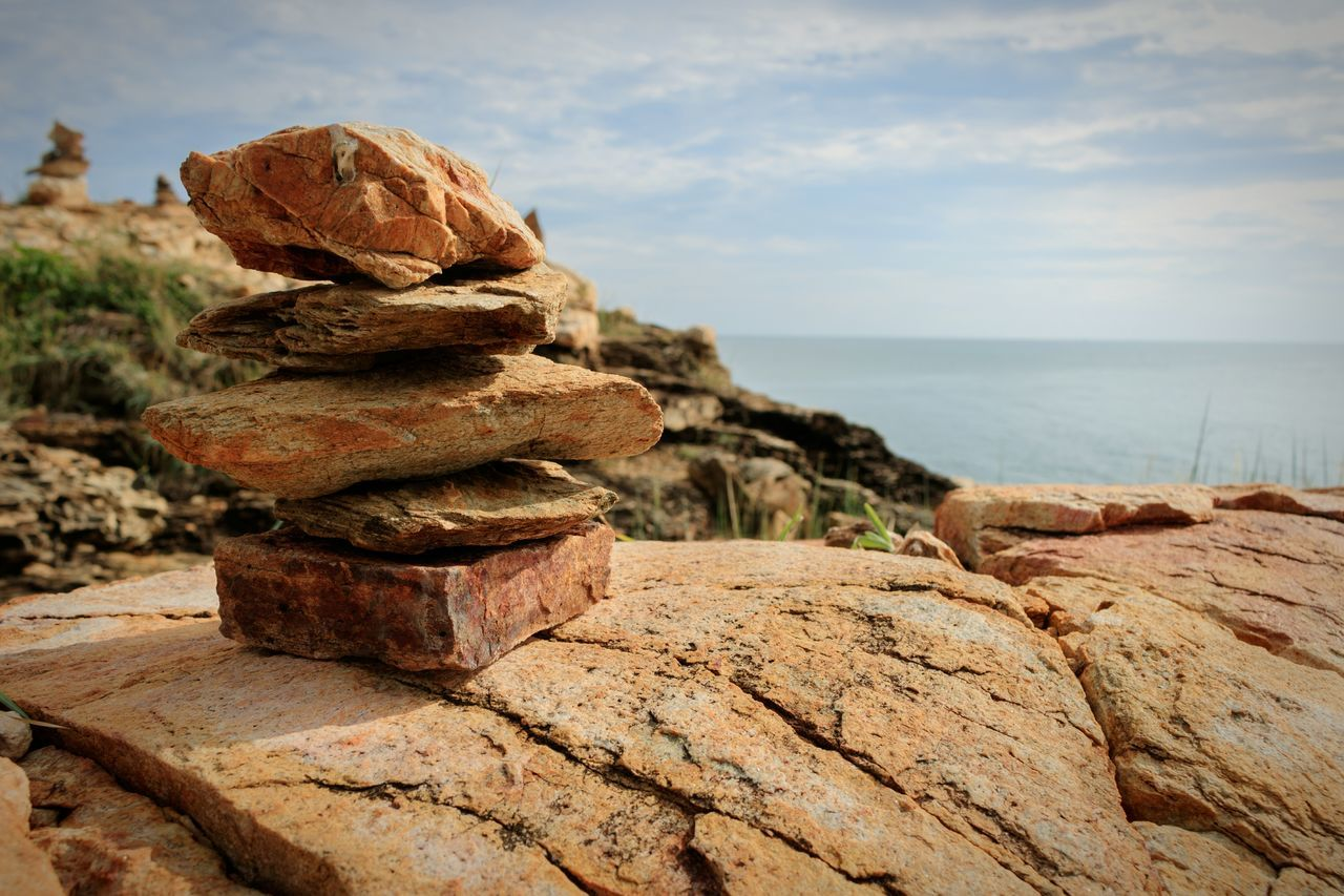 Stack Balance Rock - Object SeaBeach Stone - Object Nature Tranquil Scene Close-up Beautiful Backgrounds Buity In Nature No People Beautifully Organized Reef Sky Sky And Clouds Cloud - Sky Cloudy Outdoors Day EyeEmNewHere