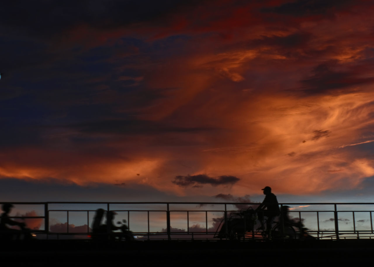 Beauty In Nature Bridge - Man Made Structure Built Structure Cloud - Sky Dusk Nature Orange Color Outdoors Pedicab People Real People Scenics Silhouette Sky Sunset Tricycle