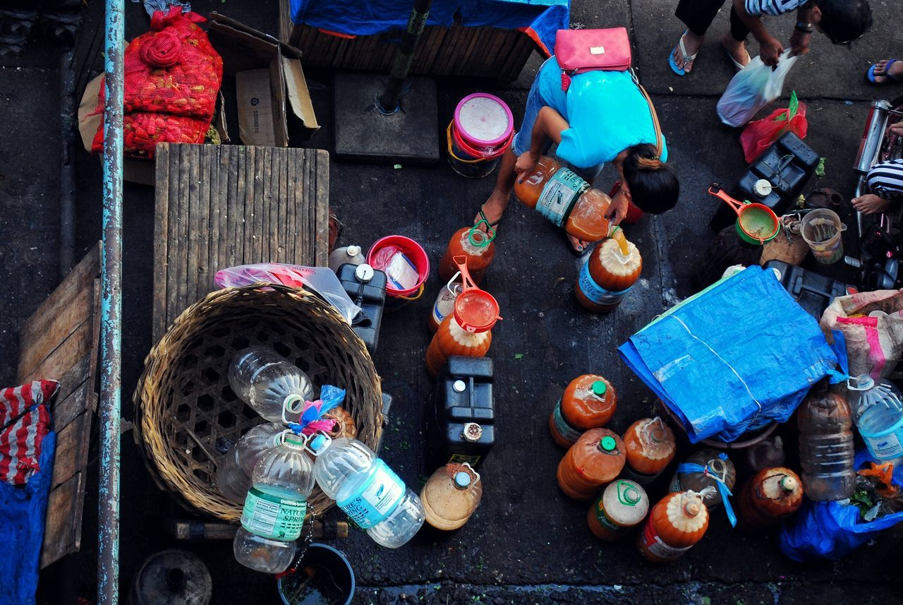Filipinos are mild drinkers. Tuba Alcoholic Drink Suka Vinegar Drink Marketplace Birdseyeview People Busy Busy Street Street EyeemPhilippines