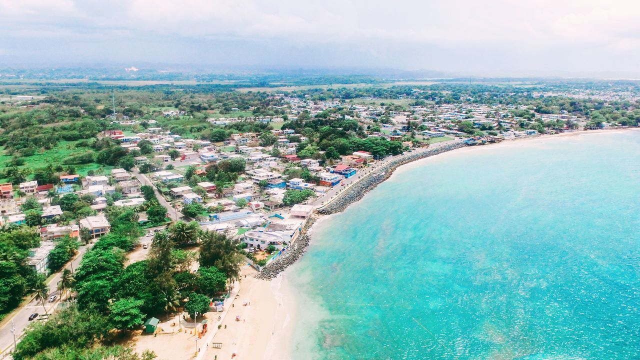 Puerto Rico Sea Sky Water Beauty In Nature Nature Outdoors Building Exterior Scenics High Angle View Day Beach Cloud - Sky Architecture Built Structure No People Tranquility Horizon Over Water Tree Landscape Cityscape Ocean View Aerial Shot Dronephotography Aerial Photography