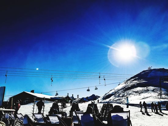 Beauty of the Montafon Sunlight Sunbeam Blue Sun Sky Lens Flare Cold Temperature Winter Snow Real People Lifestyles Nature Outdoors Leisure Activity Beauty In Nature Day Adventure Scenics Men