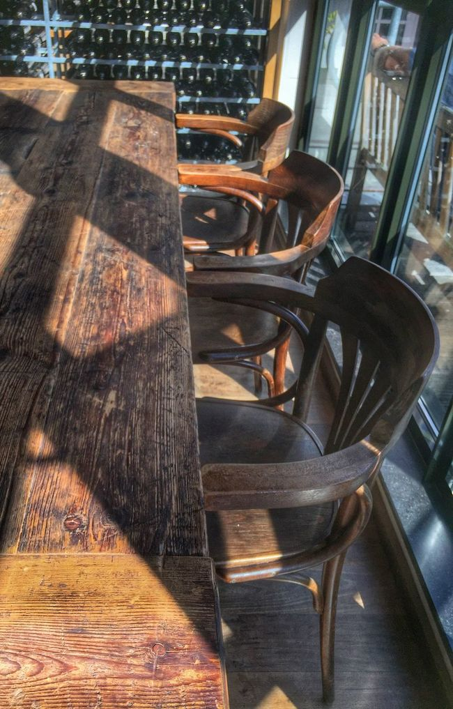 Hardwood Floor Interior Design Table Chair Wood Eye4photography  Taking Photos EyeEm Best Shots EE Love Connection! Vintage Beer Bottles Seat Indoors  Eyemphotography Eyem Best Edits Still Life Light And Shadow