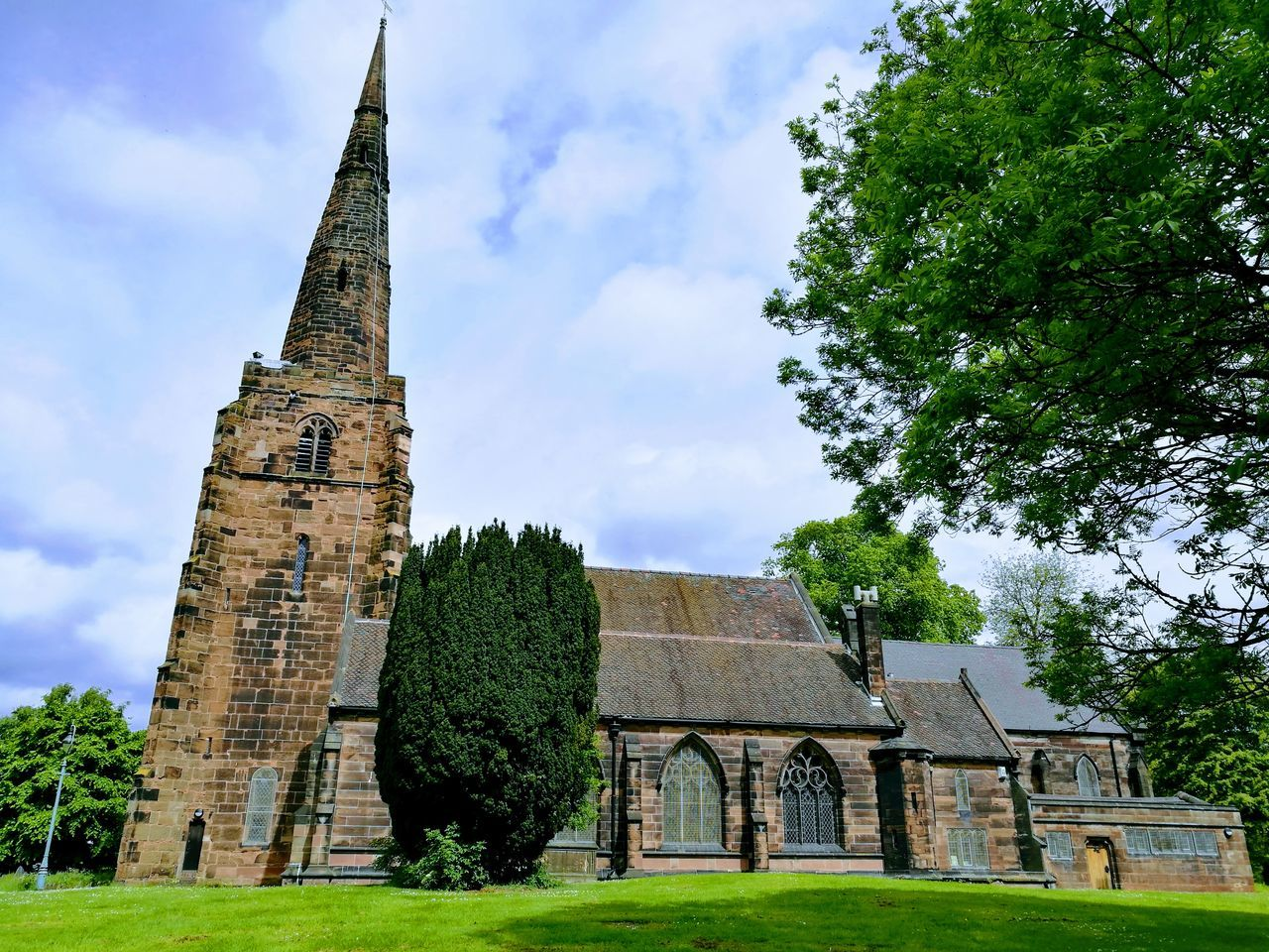 Architecture Grass History Built Structure Building Exterior Day Outdoors Tree No People Sky Nature Church Lichfield Graveyard Beauty Saint Michael Church Architecture Place Of Worship St Michaels Curch Cloud - Sky Historic History Architecture
