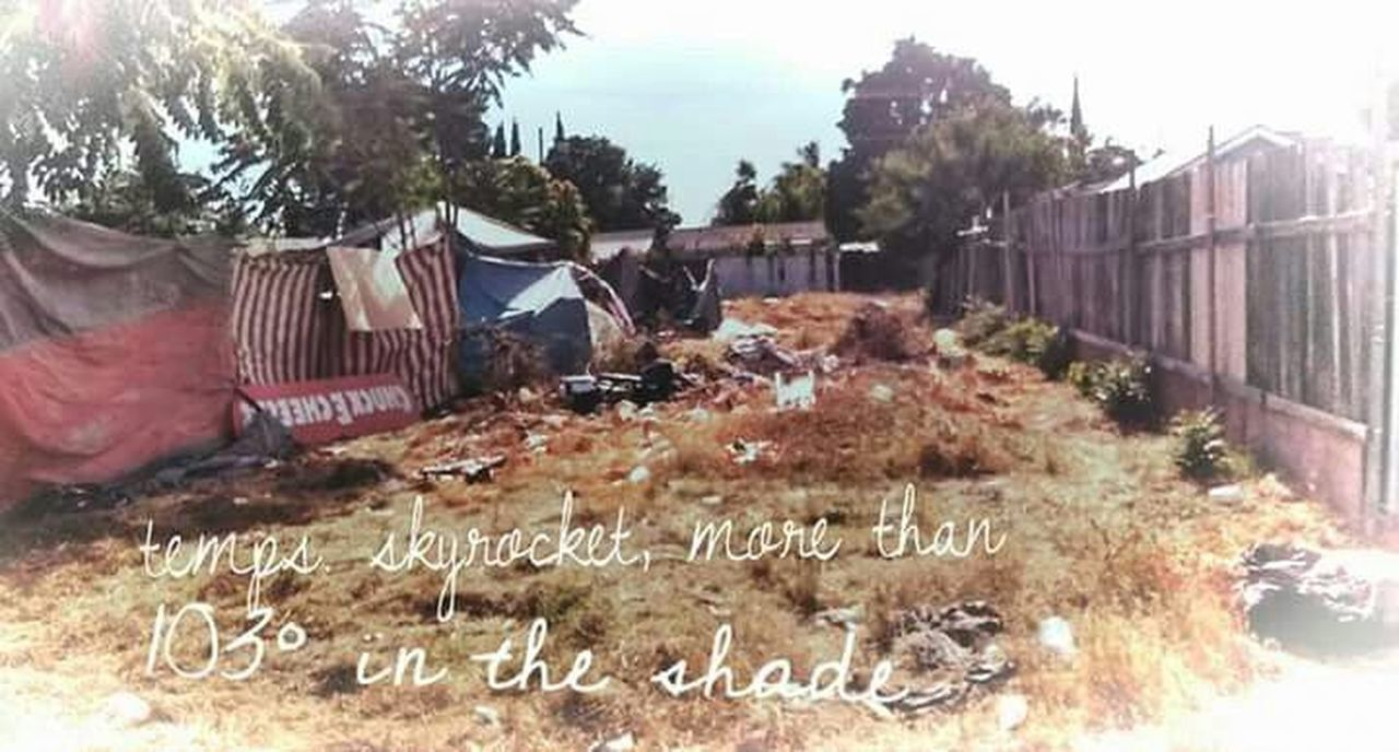 Outdoors Day Tent City Homeless Epidemic Rock Bottom Sweltering Heat 103°