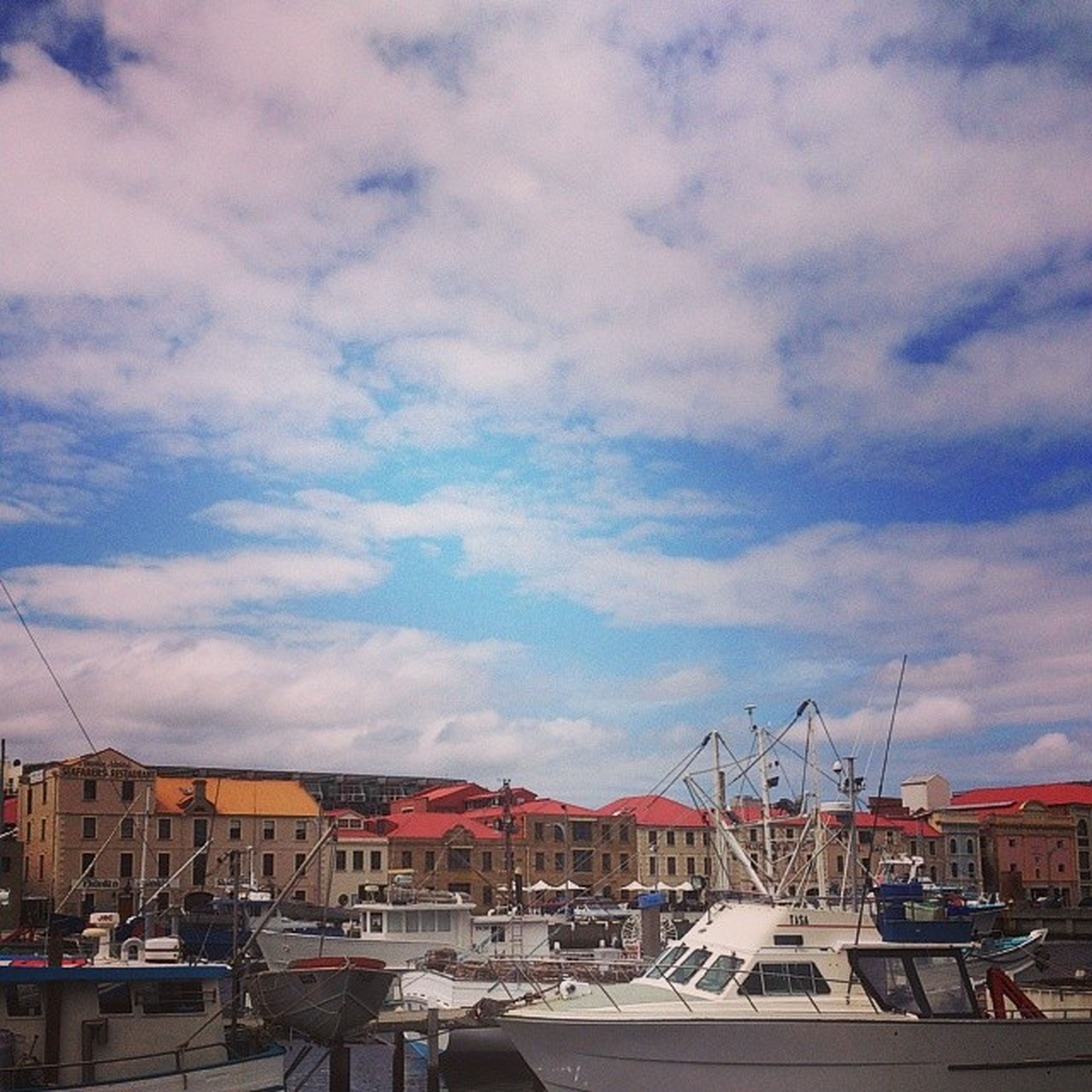 sky, building exterior, built structure, architecture, transportation, cloud - sky, mode of transport, cloudy, nautical vessel, cloud, moored, harbor, car, house, residential structure, residential building, city, land vehicle, outdoors, weather