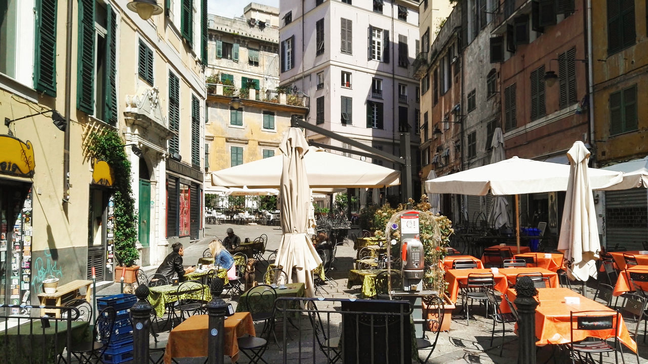 Erbe square in Genova, Italy Aperitivo Time Architecture Awning Building Exterior Built Structure Cafe Caruggi Chair City Day Genova Historical Historical Building Historical Square Italian Aperitivo Italian Lifestyle Italy Outdoors Piazza Delle Erbe Genova Piazza Erbe Real People Restaurant Retail  Sidewalk Cafe Springtime