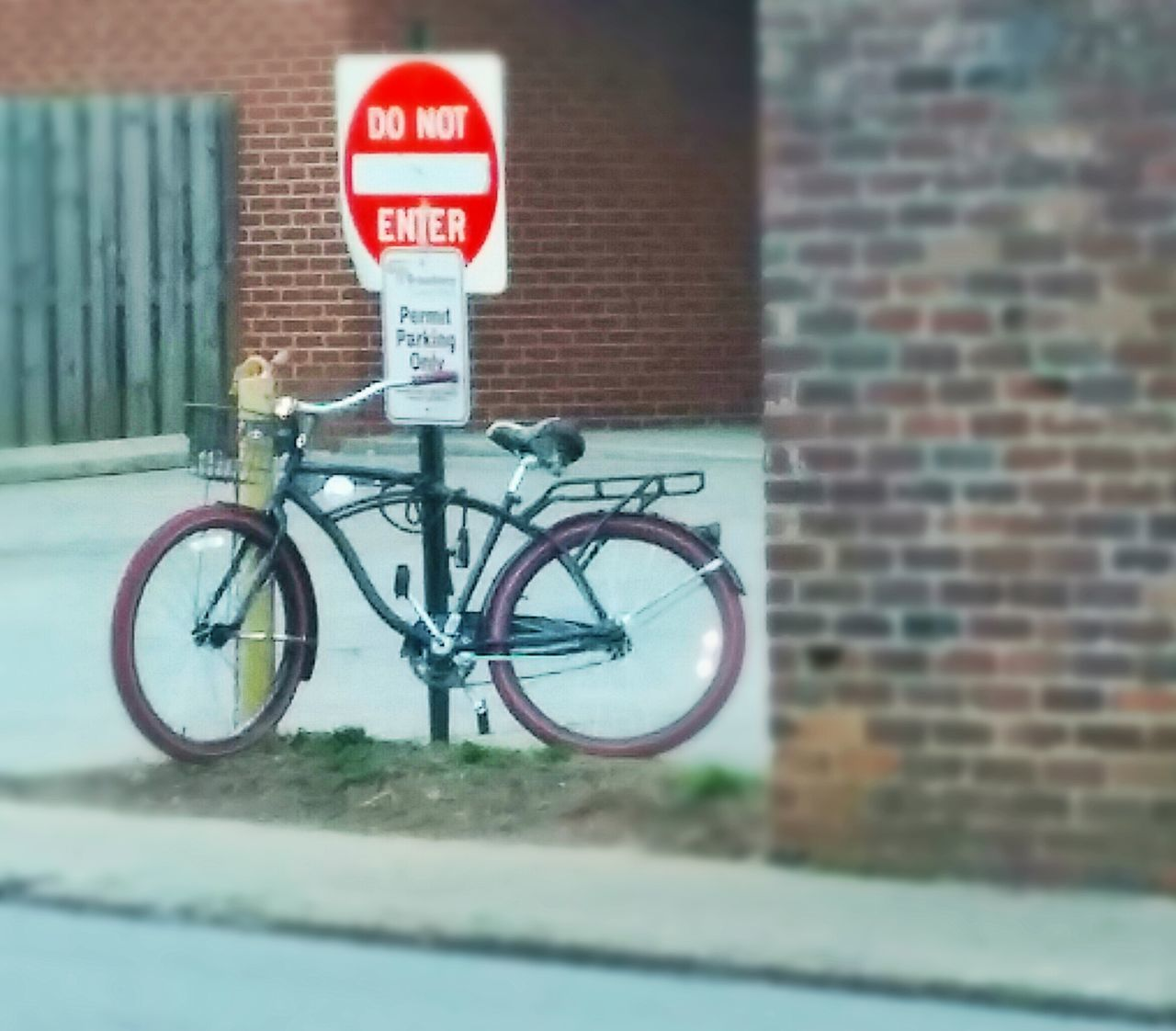 text, bicycle, communication, transportation, road sign, mode of transport, capital letter, land vehicle, warning sign, outdoors, guidance, day, no people, built structure, building exterior, architecture, close-up, city