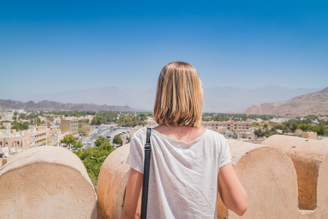Architecture Clear Sky Mountain Nature Nizwa Fort Oman One Person Outdoors Real People Rear View Scenics Travel Travel Destinations Travel Photography Traveling