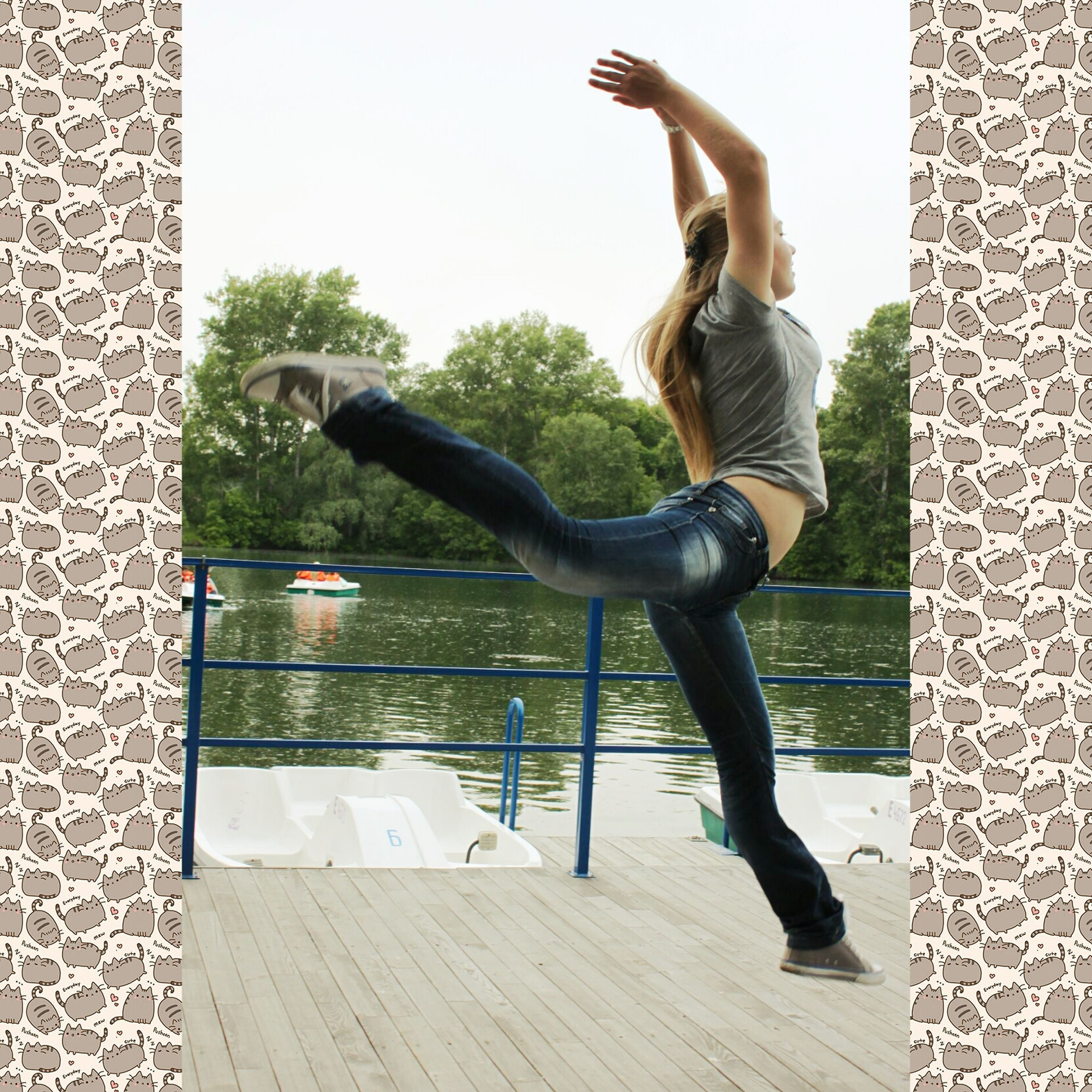 full length, lifestyles, jumping, leisure activity, mid-air, casual clothing, water, side view, fun, enjoyment, day, motion, childhood, standing, outdoors, balance, sunlight, carefree