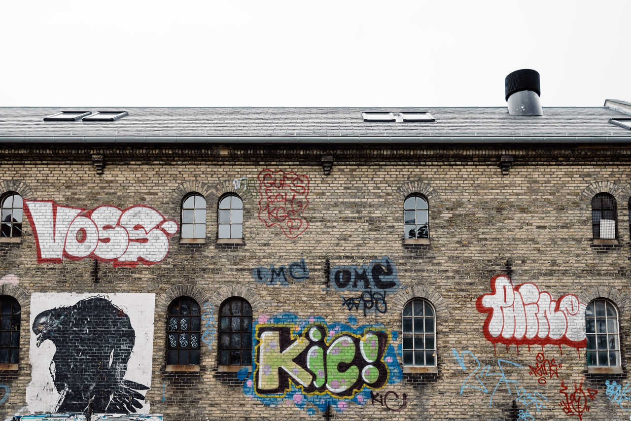 Graffitis on a wall in the Freetown of Christiania Barracks Brick Wall Christiania Clear Sky Communication Community Copenhagen Culture Drug Drugs Freedom Friends Graffiti Outdoors Text Wall Western Script