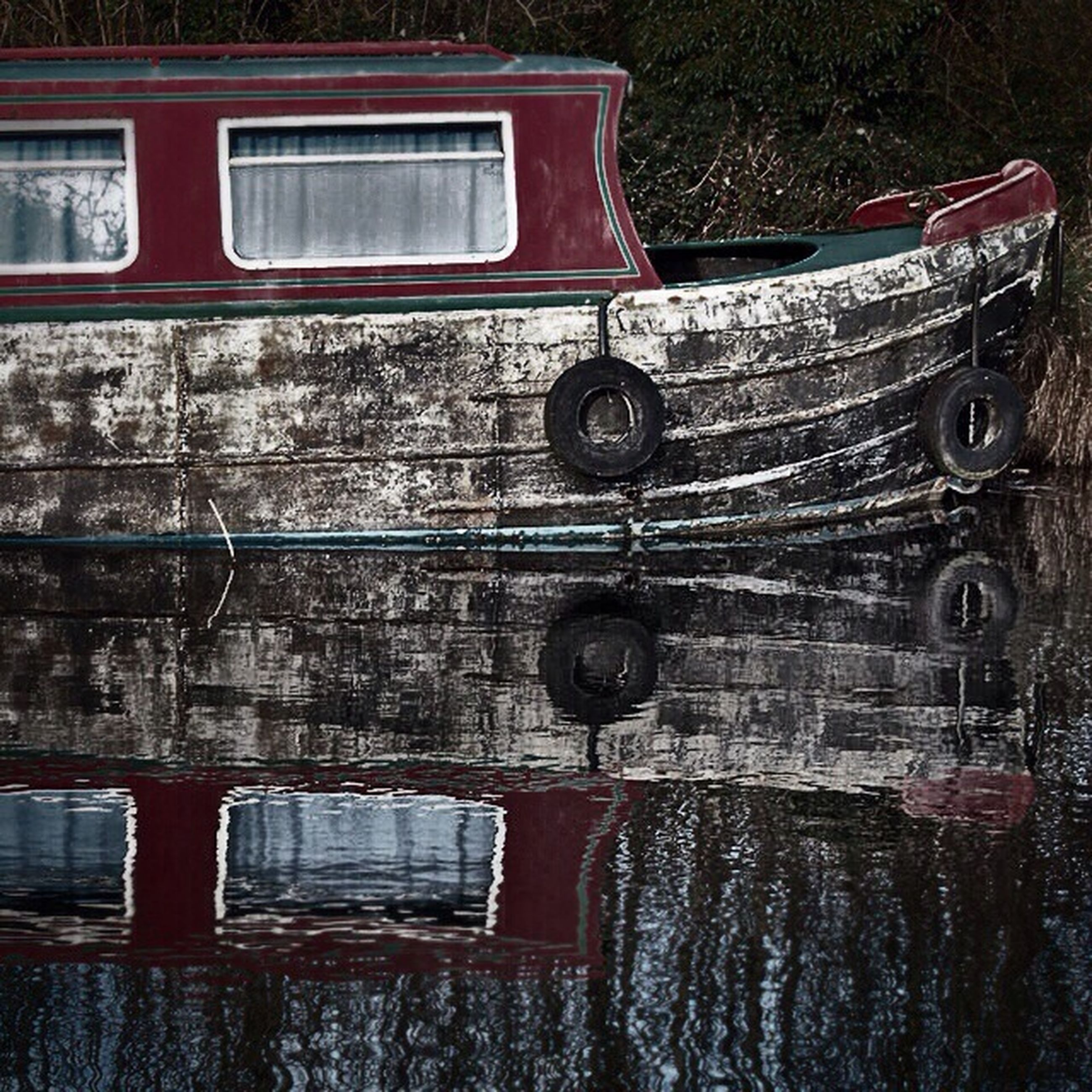 reflection, water, transportation, old, mode of transport, built structure, architecture, window, glass - material, no people, outdoors, day, abandoned, building exterior, car, old-fashioned, tree, metal, obsolete