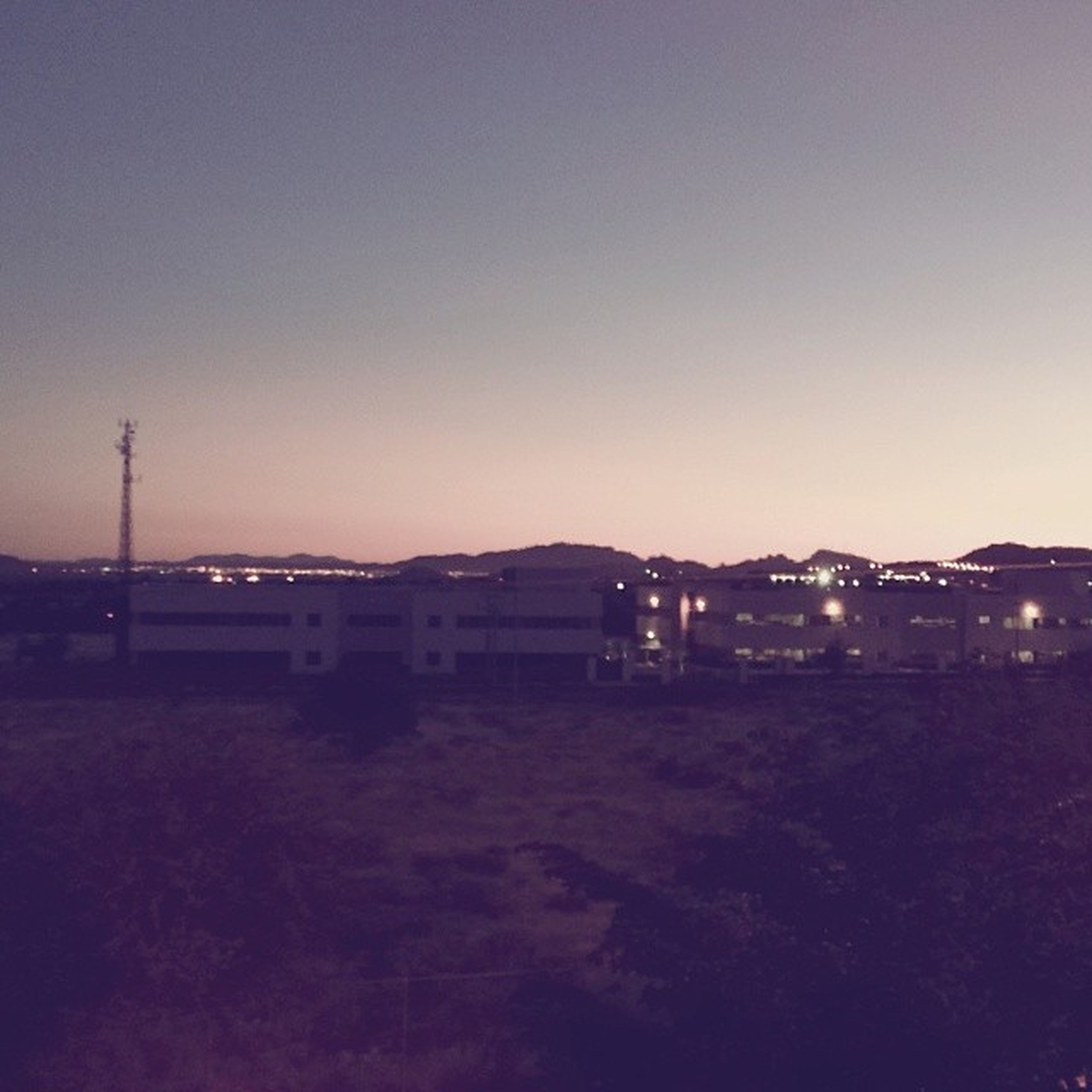 copy space, clear sky, building exterior, built structure, architecture, landscape, house, sunset, residential structure, illuminated, dusk, field, outdoors, sky, tranquility, nature, no people, residential building, night, tranquil scene