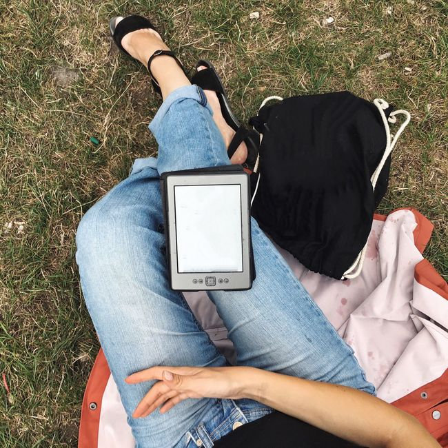Reading In The Park Girl Reading Kindle