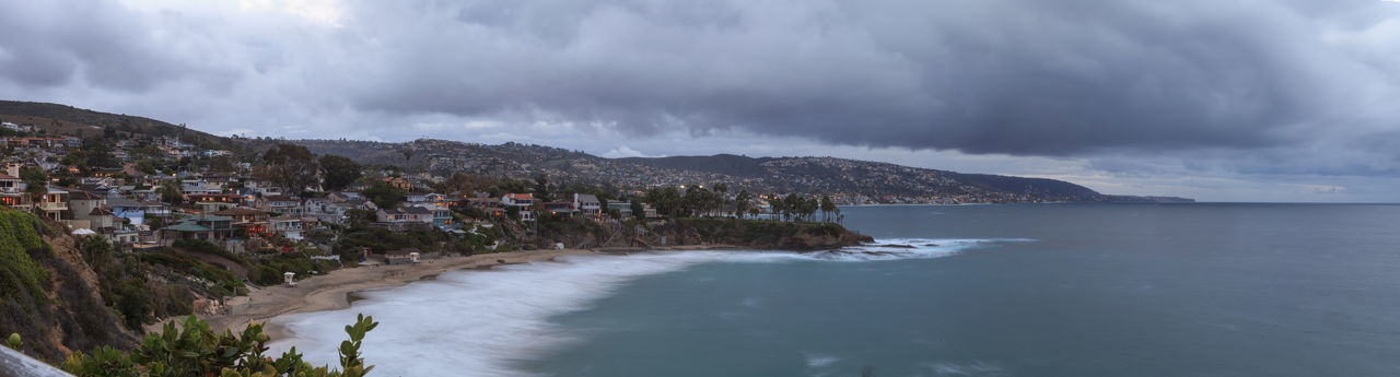 Rain clouds over Crescent Bay in the fall in Laguna Beach, California, United States Beach Cloud - Sky Clouds And Sky Crescent Bay Day Laguna Beach, CA Nature No People Outdoors Rain Rain Clounds Scenics Storm Storm Cloud Thunderstorm Tree Vacations Wave