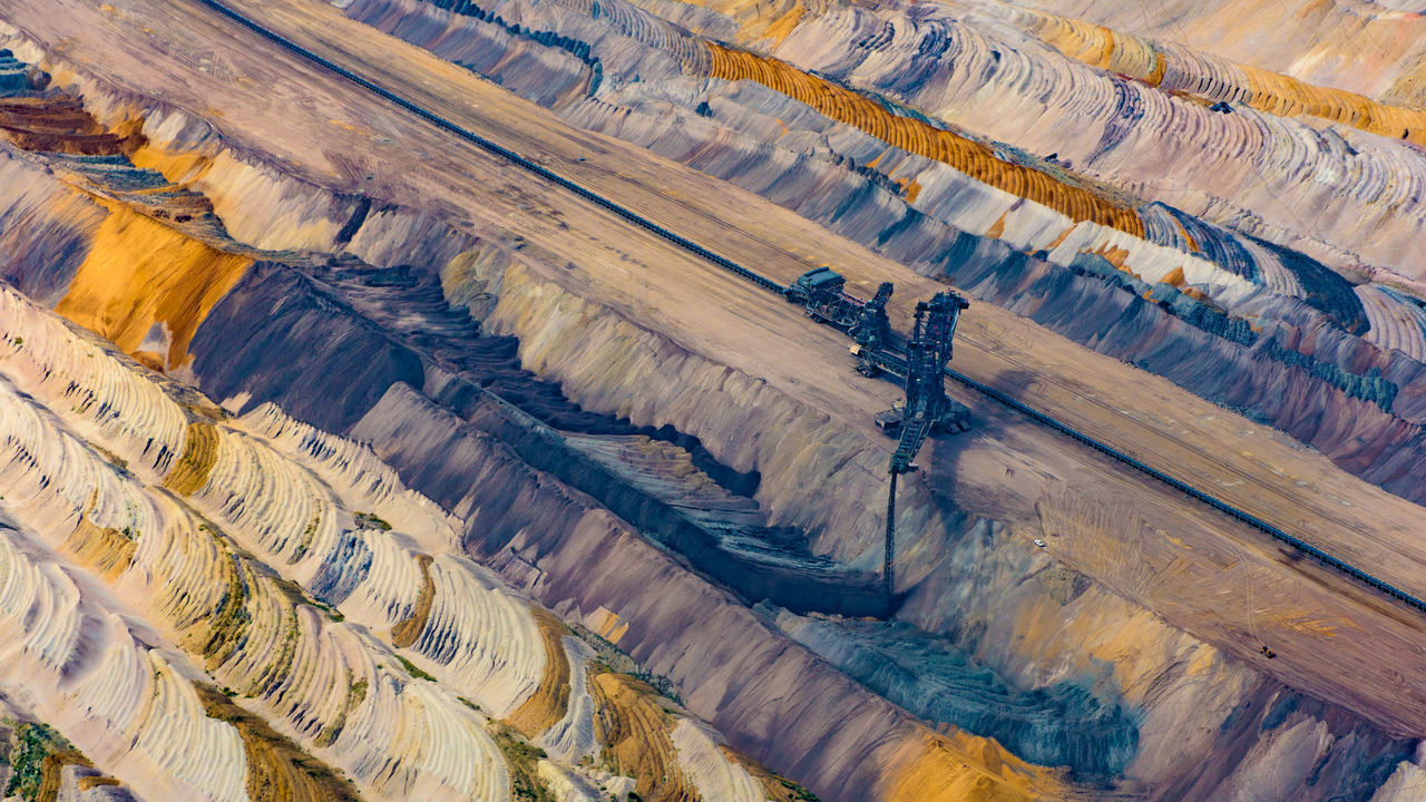 Bird's eye view of the Etzweiler mine. This hole in the earth, is as big a small city. Aerial View Abstract Colors Colourful Colours Earth Etzweiler EyeEm Best Shots From Above  Lines Mine No One No People Open Mine Open-cast Mining Open-cut Mining Open-pit Mining Polution My Year My View Flying High The Photojournalist - 2017 EyeEm Awards Texture Structure Colors Of Autumn