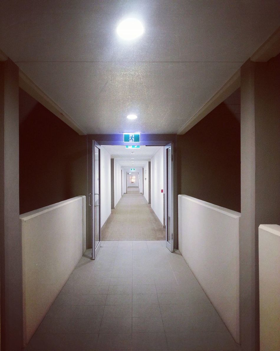 Another night here. Illuminated Empty Indoors  The Way Forward Longendless Built Structure No People Exit Sign Tunnel Architecture Corridor Quite Time Hotel Kingsliff Peppers And Salt