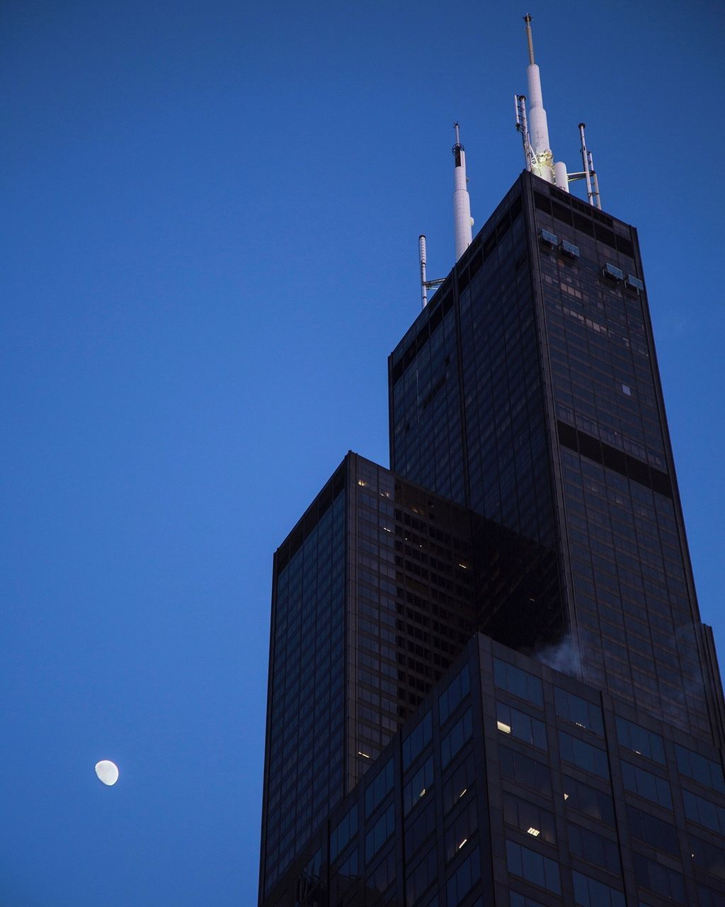 Low Angle View Of Willis Tower Against Blue Sky At Dusk