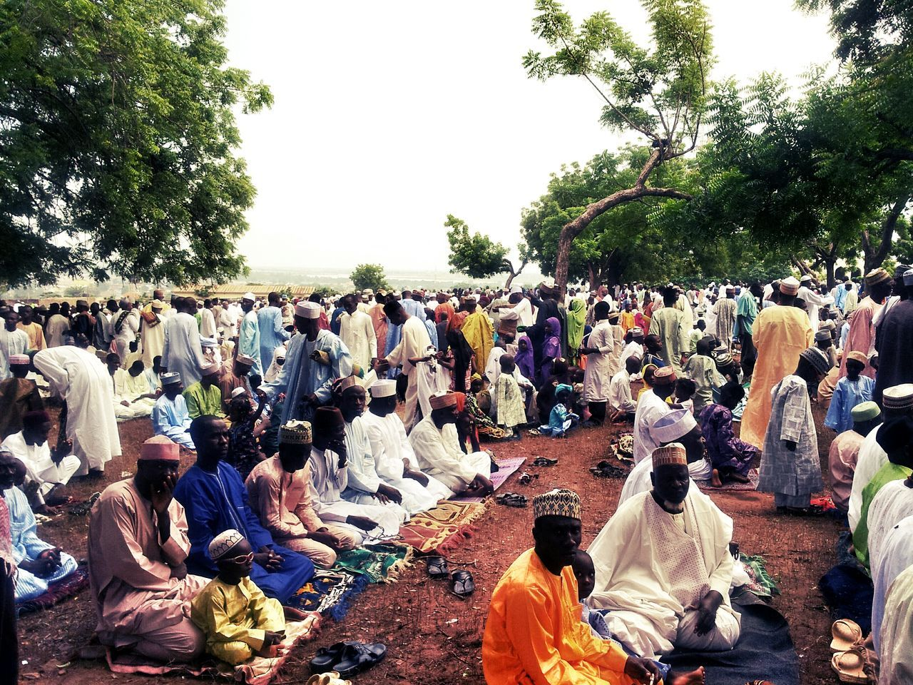 Crowd Resting On Field During Traditional Festival
