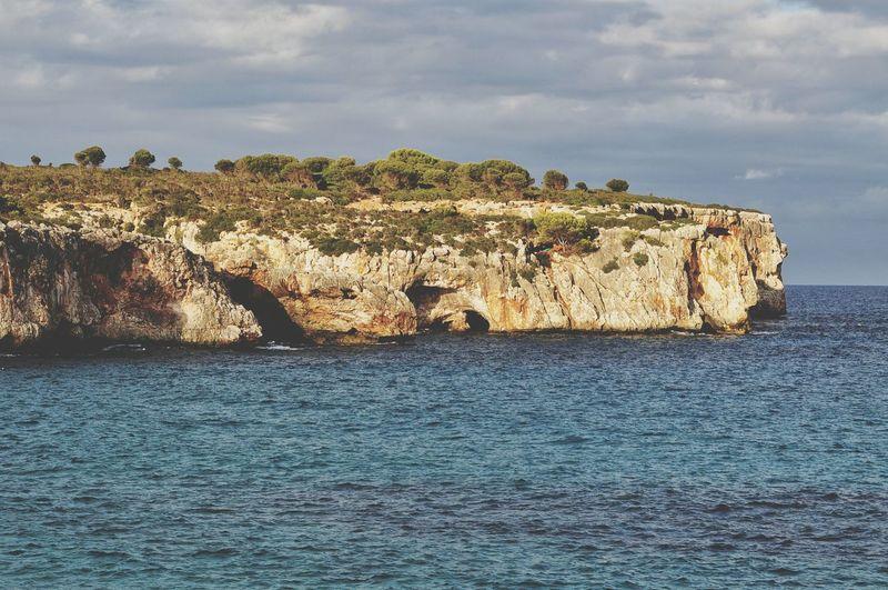 EyeEm Selects evening in cala varques on mallorca island in spain Sea Beach Rock - Object Outdoors Sky Majorca Mallorca SPAIN Evening Cliff Tranquil Scene Cala Varques