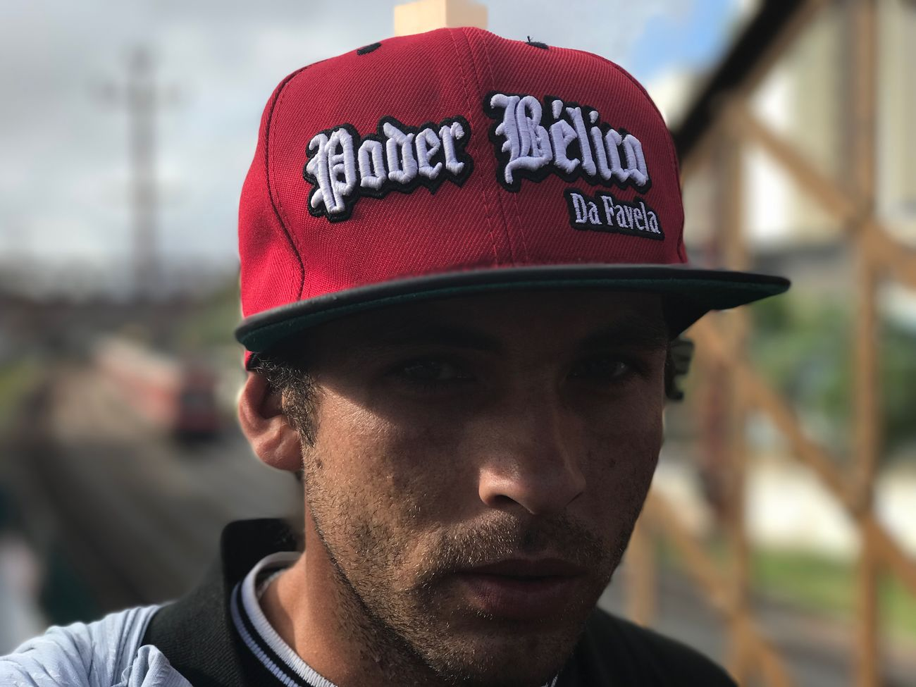 """""""Poder Bélico da Favela"""". April, 2017. Shootermag Portrait Shotoniphone7plus Focus On Foreground One Person Text Real People Young Adult Cap Young Men Day Outdoors Close-up"""