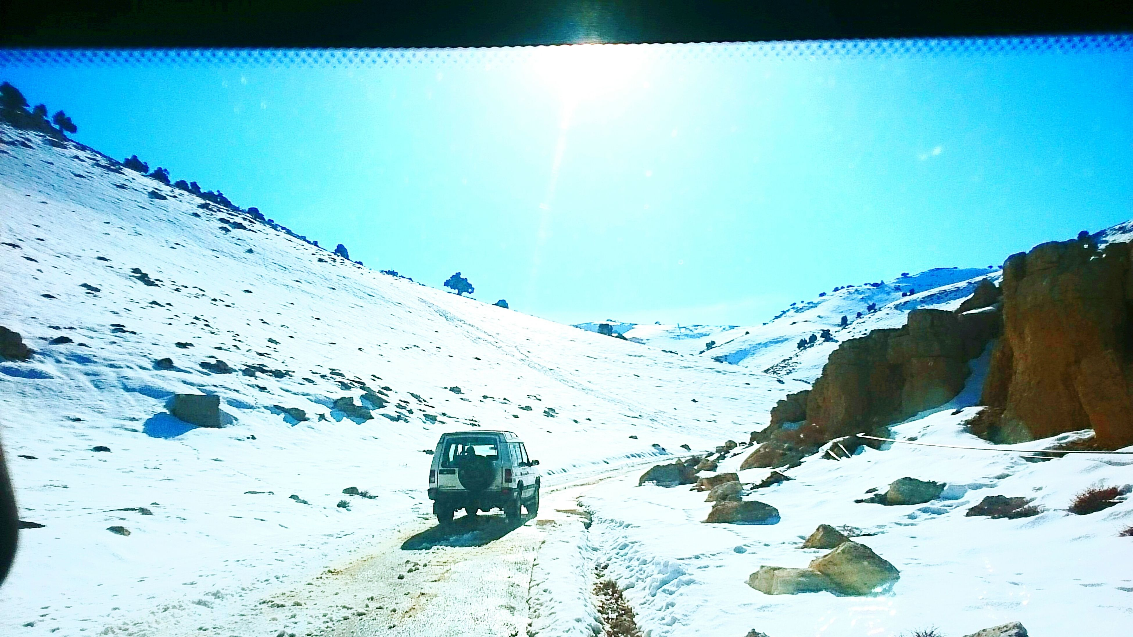 snow, winter, cold temperature, season, clear sky, weather, blue, covering, nature, frozen, sunlight, sun, mountain, tranquility, beauty in nature, landscape, copy space, tranquil scene, white color, transportation