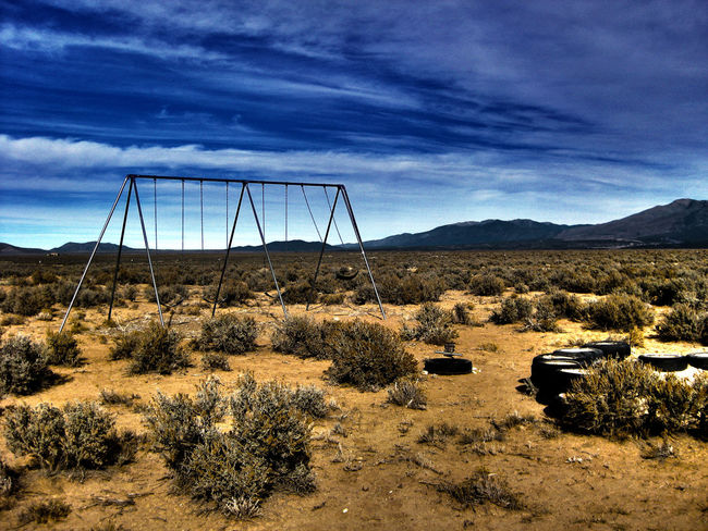pure nothing.. Beauty In Nature Dessert Empty Empty Places Empty Spaces Loneliness Middle Of Nowhere Mountain Range Newmexico No People Non-urban Scene Somewhere Swings Swingset Tranquil Scene