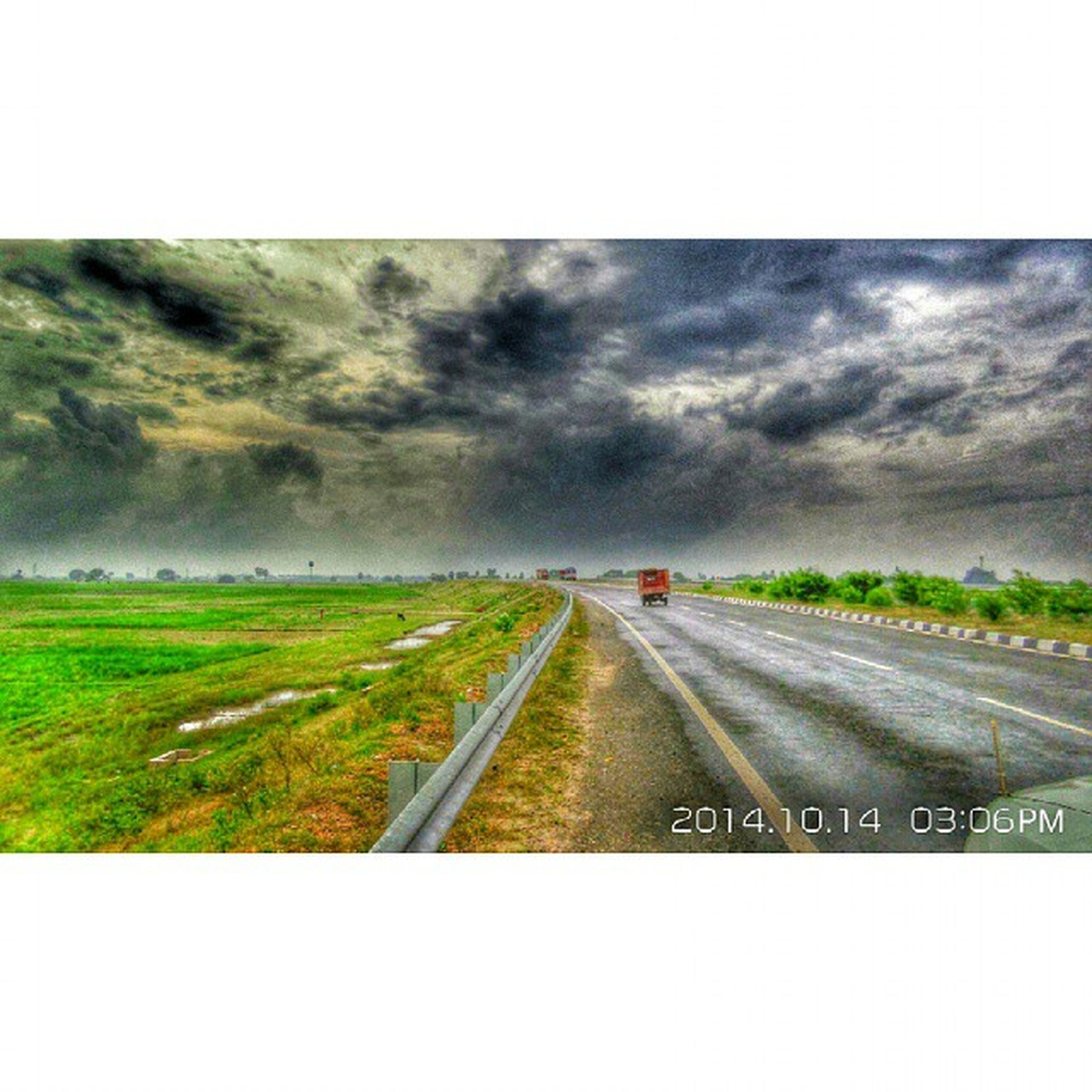 transfer print, sky, the way forward, transportation, auto post production filter, road, diminishing perspective, cloud - sky, cloudy, vanishing point, landscape, field, grass, tranquil scene, tranquility, nature, weather, overcast, country road, cloud