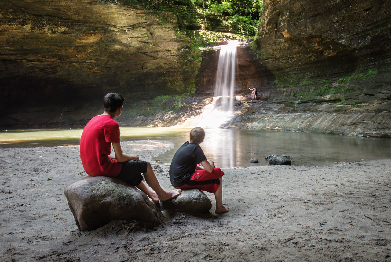 Live For The Story Scenics Tranquility Landscape Beauty In Nature Tranquil Scene Waterfall Kids Kids Playing Summertime Playing In The Water Sitting Outside Sitting Here Thinking It Through... Rocks Rocks And Water Rock Formations